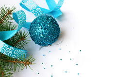 Branch of a Christmas tree and blue ball and ribbon. Christmas card Royalty Free Stock Images
