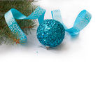 Branch of a Christmas tree and blue ball and ribbon Royalty Free Stock Photography