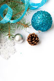 Branch of a Christmas tree and blue ball and ribbon Stock Photos