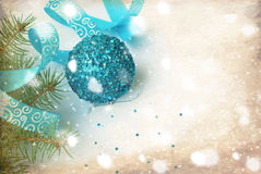 Branch of a Christmas tree and blue ball and ribbon Stock Image