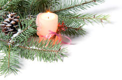 Branch of Christmas tree with candle and pinecone Stock Photography