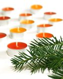 branch of Christmas tree and candles on white Royalty Free Stock Photo