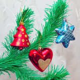 Branch of Christmas tree with colorful bauble Stock Photos