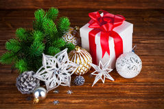 Branch of Christmas tree with gift Royalty Free Stock Photography