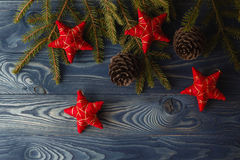 Branch of Christmas tree with pinecone and stars Stock Photos