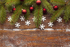 Branch of Christmas tree, red baubles and snowflakes Stock Image