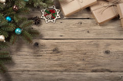 Branch of a Christmas tree with toys and Christmas gifts Royalty Free Stock Image