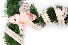 Branch of Christmas tree wrapped a pink ribbon Stock Photography