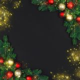 The branch of a Christmas tree with xmas decorations and magical royalty free stock image
