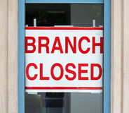 Branch Closed. A sign in a store window reading Branch Closed Stock Image