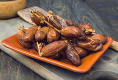 Branch of date fruits on wood Stock Images