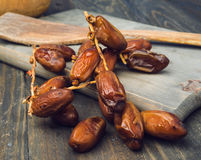 Branch of date fruits on wood Royalty Free Stock Images
