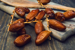 Branch of date fruits on wood Royalty Free Stock Photos