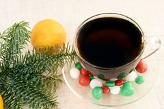 Branch eaten. Hot tea. Multicolored candy. Mandarin. Light white background Stock Image