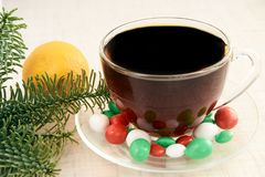 Branch eaten. Multicolored candy. Hot tea. Mandarin. White background. New year Stock Photos