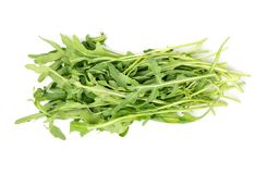 Branch of fresh arugula. Bunch of fresh arugula isolated on white background, top view stock image