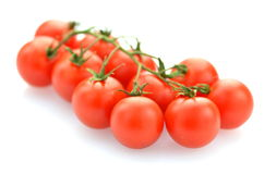 Branch of fresh cherry tomatoes isolated on white Stock Image