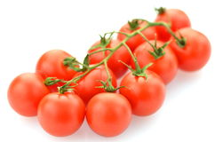 Branch of fresh cherry tomatoes isolated on white Stock Photo