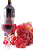 Branch of grapes, bottle of wine and glass Royalty Free Stock Photo
