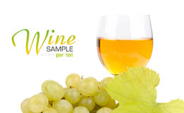 Branch of grapes and glass of wine. Isolated on white background Royalty Free Stock Photos