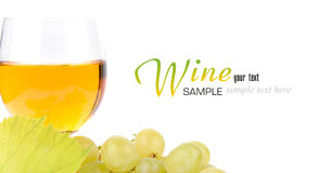 Branch of grapes and glass of wine. Isolated on white background Stock Image