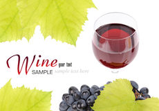 Branch of grapes and glass of wine. Isolated on white background Stock Photo