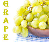 Branch of green fresh grapes in a wooden bowl on white Stock Image