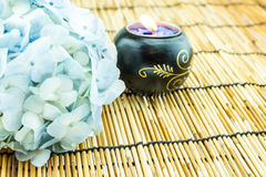 Branch of light blue hydrangea flower with candle  on bamboo bli Stock Images