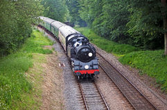 Branch line steam. Old vintage steam train on a branch line taking passengers for short trips through scenic rural countryside Royalty Free Stock Photos