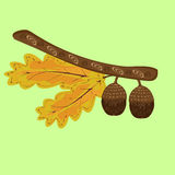 Branch of oak with acorns and leaves autumn background ethnic Royalty Free Stock Photo