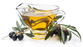 Branch with olives and olive oil Stock Photography