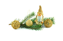 Branch of pine decorated with Christmas toys. At green pine branch decorated with Christmas toys. Human figure and wooden balls. Isolated on white Stock Photos