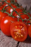 Branch of ripe tomatoes and one sliced ??fruit close up Stock Image
