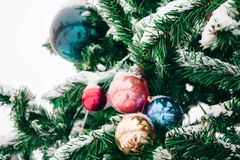 branch with snow of Christmas tree with colored Christmas ball outdoors, new year concept royalty free stock images