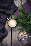 Branch of spruce, warm sweater and cup  coffee with sugar Royalty Free Stock Photo