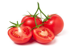 Branch of tomato with half isolated on white background Royalty Free Stock Images