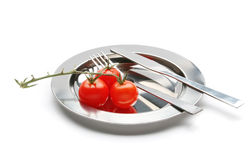 Branch of tomato on plate Stock Image