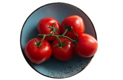 A branch of tomato on a sea-green plate, a turquoise plate. Isolated object stock photo