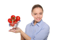 Branch with tomatoes in trolley on the women palm Stock Photography