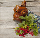 A branch of viburnum on a wooden table. Stock Image