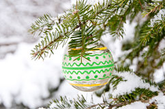 Branch with yellow and green Christmas decoration Stock Images
