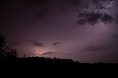Branched lightning. Bright branched lightning in thunderstorms Stock Images