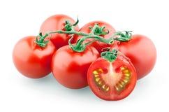 Branchement des tomates-cerises et de la cerise coupée en tranches Images stock