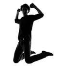 Brancher de silhouette de jeune homme heureux Images stock