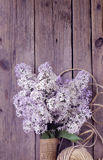 Branches of blooming lilacs on wooden background Royalty Free Stock Photography