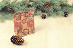 Branches of blue spruce, cones and paper shopping gift bag Stock Images