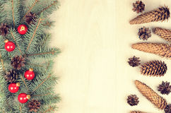 Branches of blue spruce, red balls and fir cones on a wooden bac Royalty Free Stock Photography