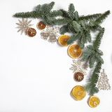 Branches of a Christmas tree with dry oranges and New Year`s toys. Christmas card royalty free stock photography