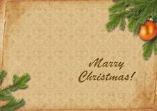 Branches of a Christmas tree on old lpaper. Retro. Royalty Free Stock Photography