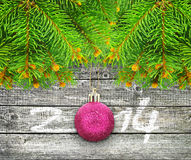 Branches of  Christmas tree on a  wooden background. Stock Image